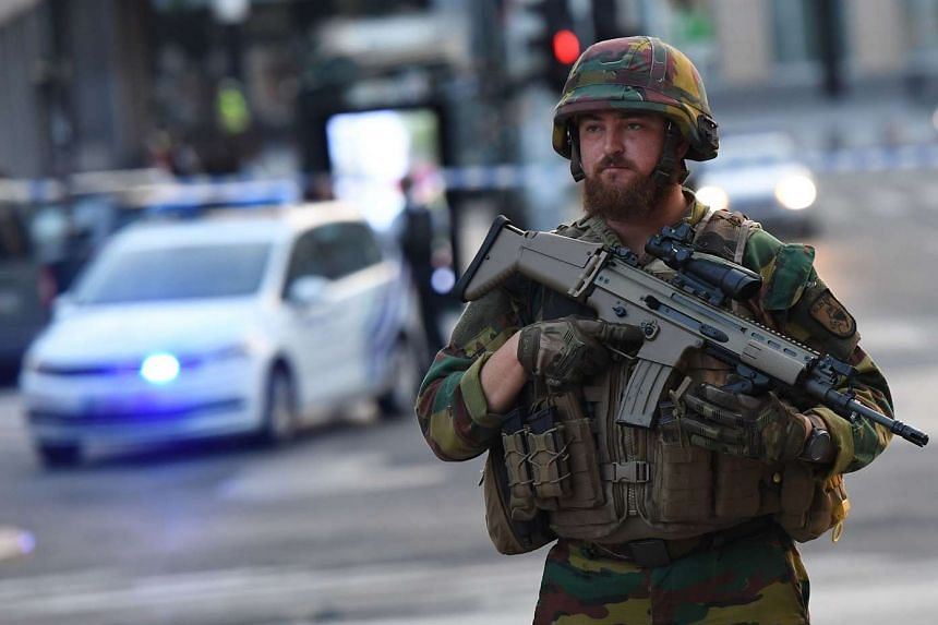 A soldier cordons off an area outside the Brussels station on June 20, 2017.