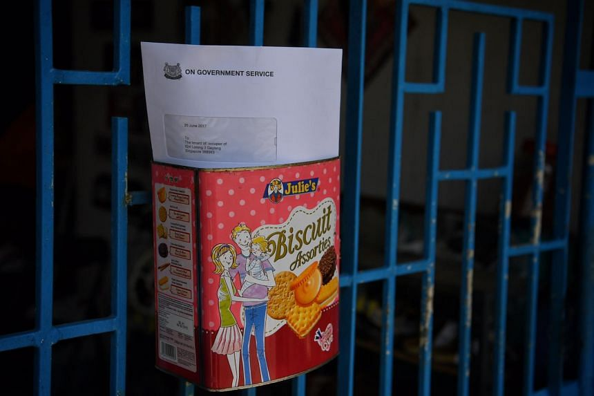 A letter from the SLA informing residents about the end of lease is seen in a make-shift postbox of one of the affected units along Geylang Lorong 3.