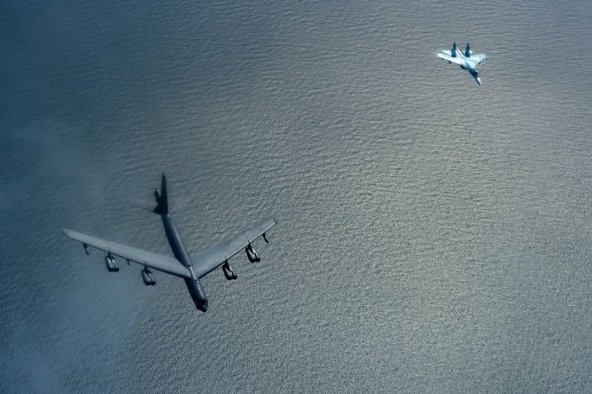 A US B-52 Stratofortress (left) is shadowed by a Russian SU-27 during exercises over the Baltic sea, June 9 2017.