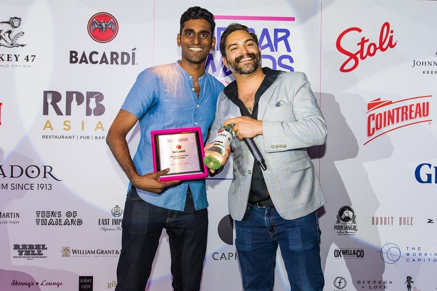 Bartender of the Year Vijay Mudaliar (far left) with Mr Ricky Paiva, brand ambassador of Bacardi-Martini Singapore, who presented him with the award.