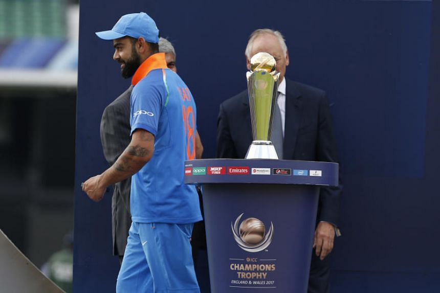 India's Virat Kohli looks dejected as he walks past the ICC Champions Trophy after his country lost in the final to Pakistan on June 18.