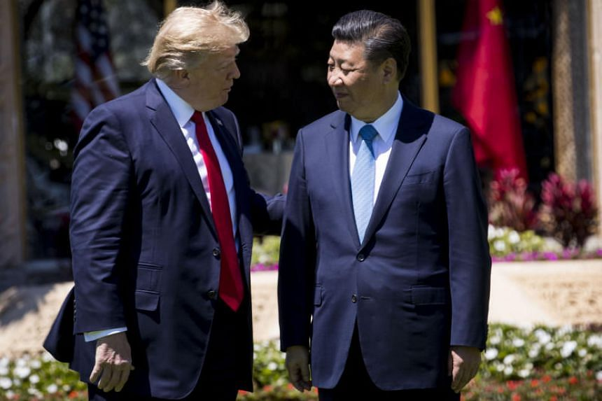 US President Donald Trump (left) walks with President Xi Jinping of China at Trump's Mar-a-Lago resort in Palm Beach, Florida, on April 7, 2017.