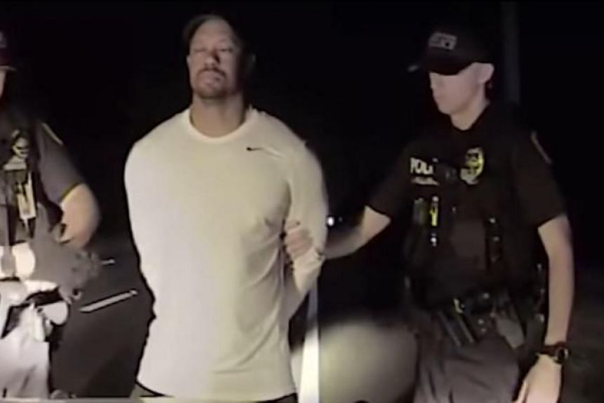 This still image released by the police shows golfer Tiger Woods being arrested on May 29.
