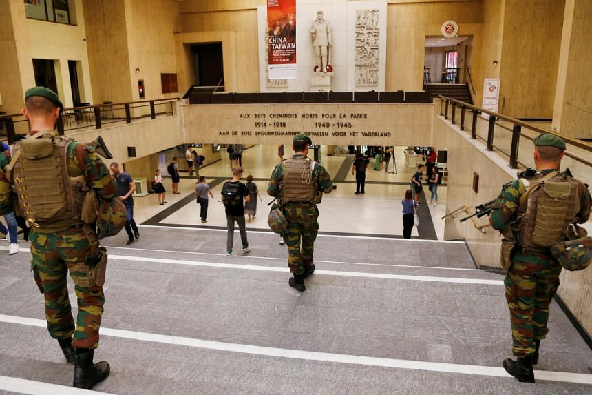 Belgian soldiers patrol inside Brussels central railway station after a suicide bomber was shot dead by troops in Brussels, Belgium, on June 21, 2017.