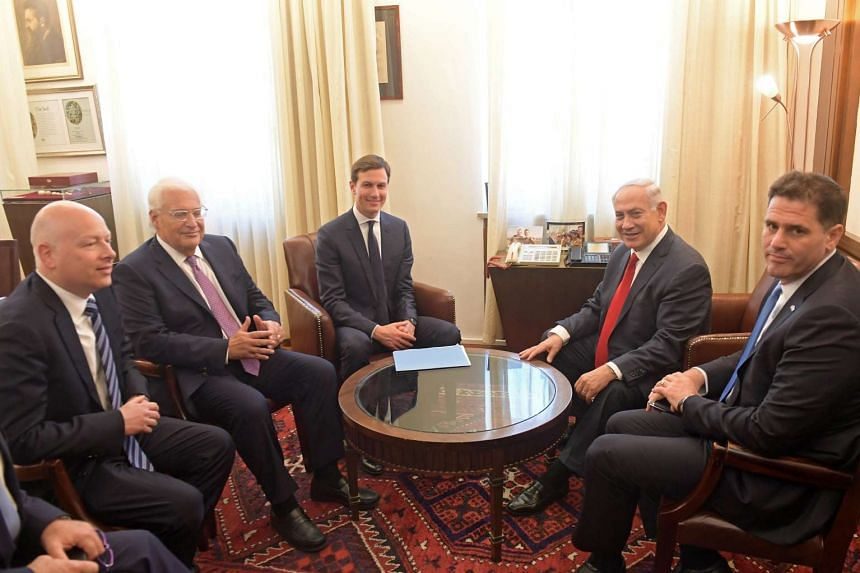 Israeli Prime Minister Benjamin Netanyahu (second from right) sits for a meeting with Jared Kushner (centre) in Jerusalem.
