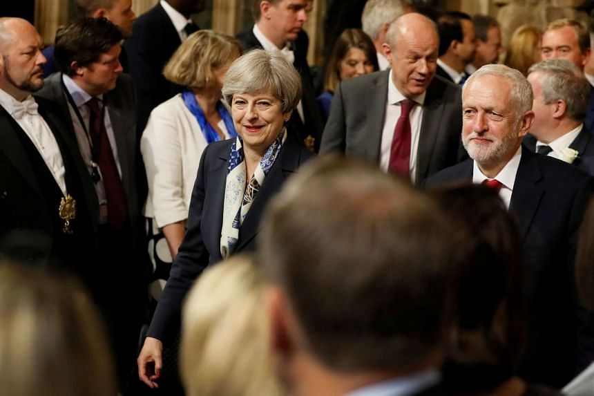 Theresa May and opposition Labour Party leader Jeremy Corbyn at the State Opening of Parliament, June 21, 2017.