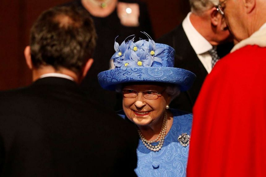 Britain's Queen Elizabeth smiles as she arrives to attend the State Opening of Parliament.