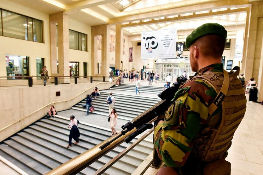A Belgian soldier stands guard in central station in Brussels, Belgium on June 21, 2017.