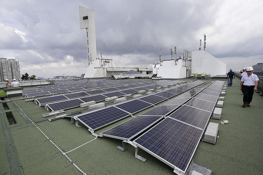 Solar panels on the rooftop of Jurong Town Hall. The agreement will enable Sun Electric to generate up to 5 megawatt-peak of electricity, which will be fully exported to Singapore's electricity grid. Power generated under existing solar leasing model
