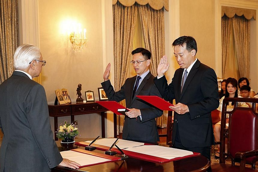 President Tony Tan Keng Yam yesterday officiated at the Swearing-in and Appointment Ceremony of Mr Png Cheong Boon (far right) as the Second Permanent Secretary for the Ministry of Trade and Industry, and Mr Lai Chung Han as the Second Permanent Secr