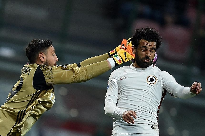 Roma midfielder Mohamed Salah vying for the ball with AC Milan goalkeeper Gianluigi Donnarumma. Salah had 15 goals and 11 assists in the past Italian Serie A season, and has caught the eye of Liverpool again.