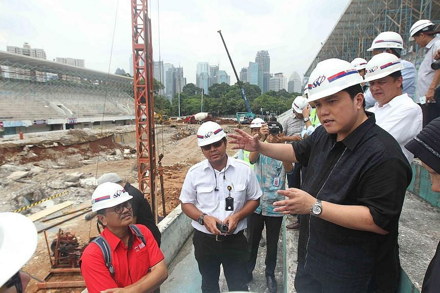 Erick Thohir (right), chairman of the Indonesia Asian Games Organising Committee, inspecting the progress of the construction of a new aquatic stadium in the Gelora Bung Karno Complex.