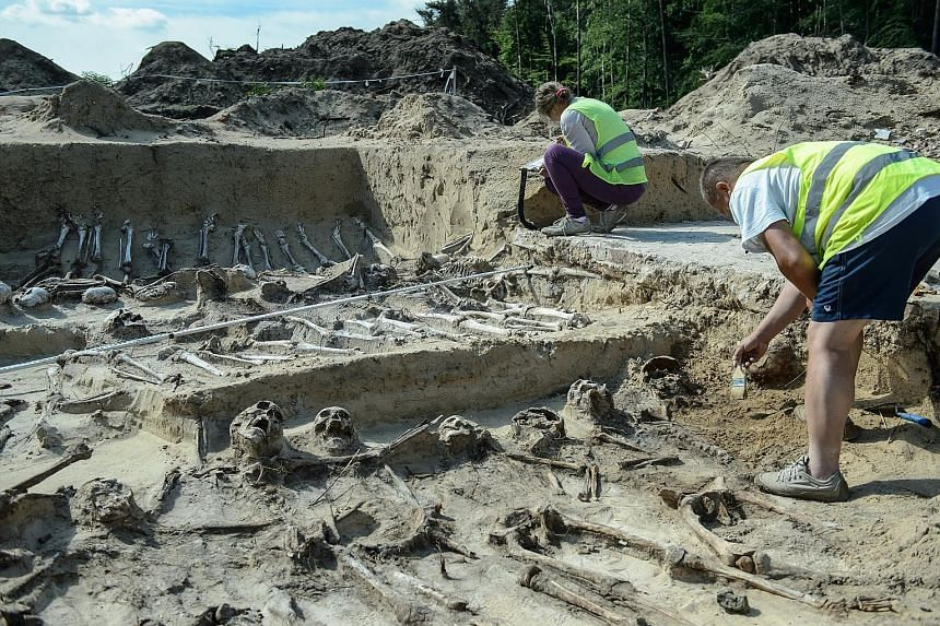 Archaeologists at work during excavations at expressway building S-17 Lublin - Warsaw in Zerdz, eastern Poland, yesterday. Scientists have discovered a burial place of what they believe were participants in the Battle of Zyrzyn that took place in 186