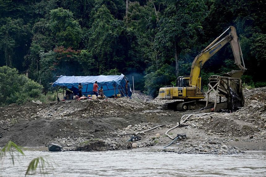 An illegal gold mine on the banks of the Tabir river in Indonesia's Sumatra island. With no regulation in the early days of the boom, miners became bolder and started openly using excavators.