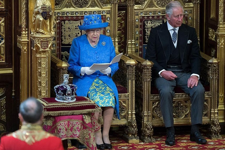 Queen Elizabeth, with Prince Charles beside her, delivering the Queen's Speech during the state opening of Parliament in London yesterday. Lawmakers will spend the next few days debating the government programme before bringing it to a vote next Thur