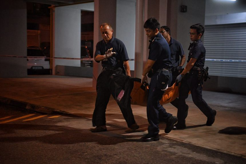 A second body is taken away from the flat at Block 717, Bedok Reservoir Road.
