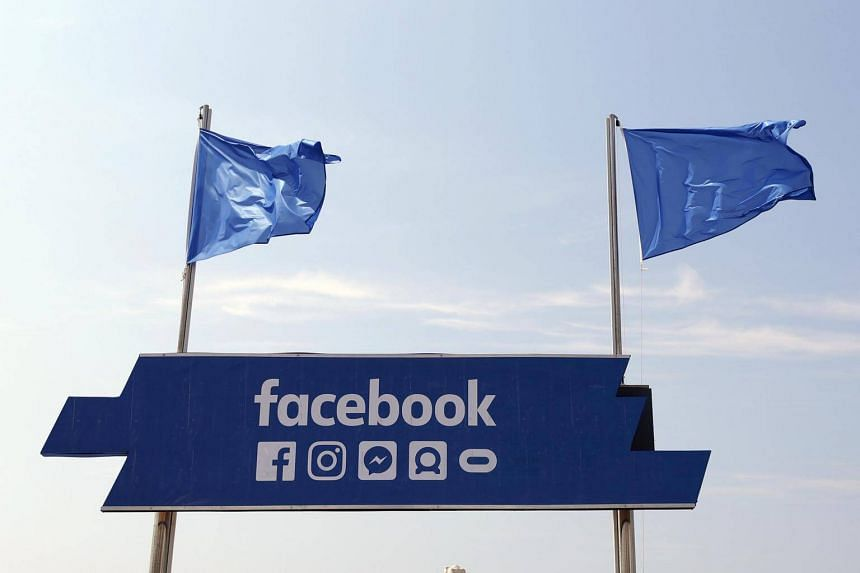 The logo of the social network Facebook is seen on a beach during the Cannes Lions Festival in Cannes, France.