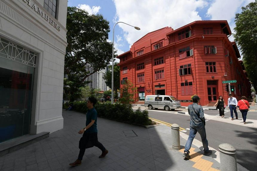 The Ministry of Law, which is taking over the Red Dot Traffic Building (right), will be restoring it to its off-white hue so that it blends in with Maxwell Chambers.