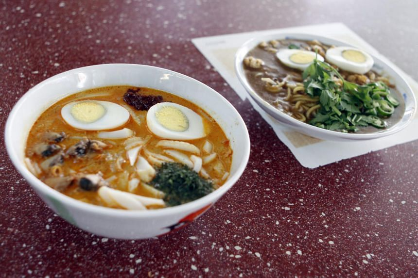 Laksa (left) and mee rebus from Famous Sungei Road Trishaw Laksa.