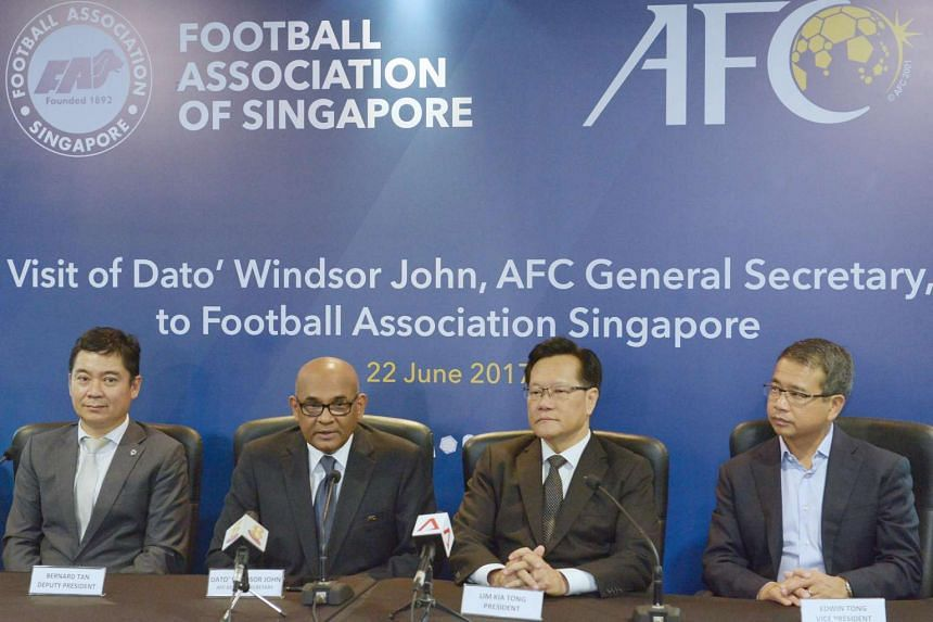 AFC general secretary Windsor John with (from left) FAS deputy president Bernard Tan, president Lim Kia Tong and vice-president Edwin Tong. He says AFC will tap its vast network of contacts to find suitable specialists.