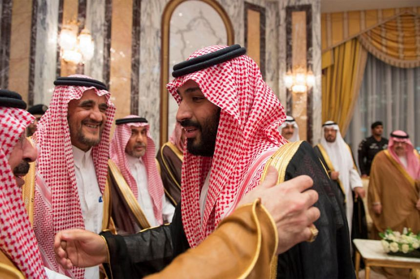 Saudi Arabia's Crown Prince Mohammed bin Salman (right) speaks with members of the royal family during an allegiance pledging ceremony in Mecca.