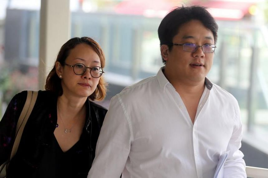 Ong Jenn and his wife arriving at the State Courts on Thursday.