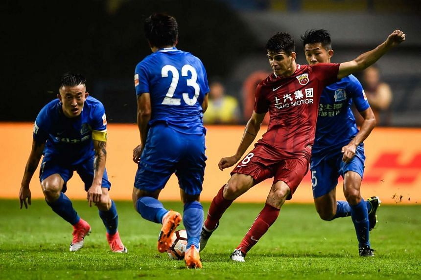 Shanghai SIPG's Oscar (in red) kicking the ball at a Guangzhou R&F player (23) in an incident that led to a brawl during their Chinese Super League match in Guangzhou, China on June 18, 2017.