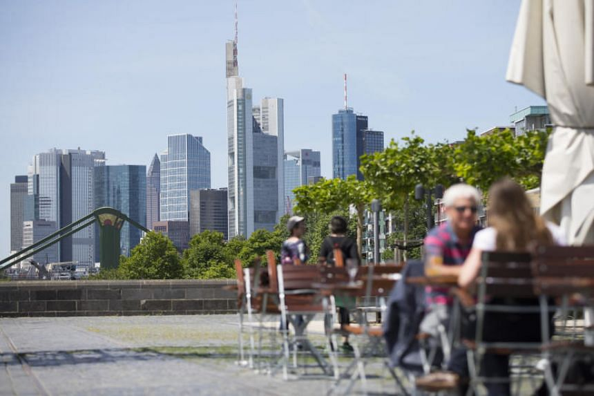 Patrons at a cafe in Frankfurt, Germany. Japan's biggest brokerage Nomura will start preparations this month to base its EU headquarters in the German city after Brexit.