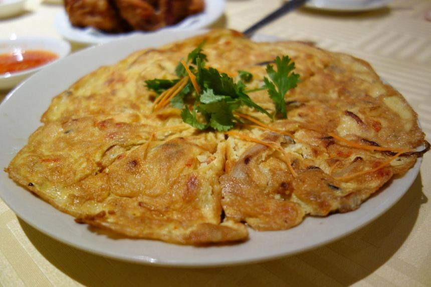 Egg foo yong, a crisp omelette filled with chopped-up prawns, from Ka-Soh Seafood.