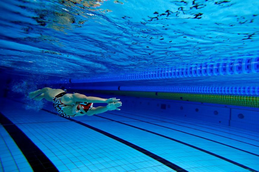 Hungarian swimmer Katinka Hosszu propels herself underwater at a training session in Budapest, Hungary.