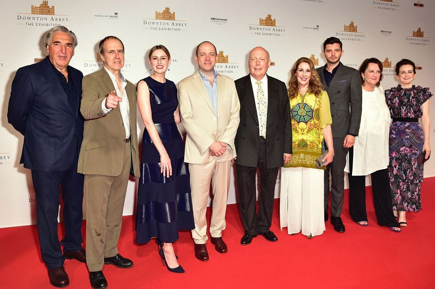Downton Abbey's (from left) Jim Carter, Kevin Doyle, Laura Carmichael, Gareth Neame, Julian Fellowes, Phyllis Logan, Michael Fox, Liz Trubridge and Sophie McShera at the red carpet event for the premiere of the show's immersive exhibition at Sands Ex