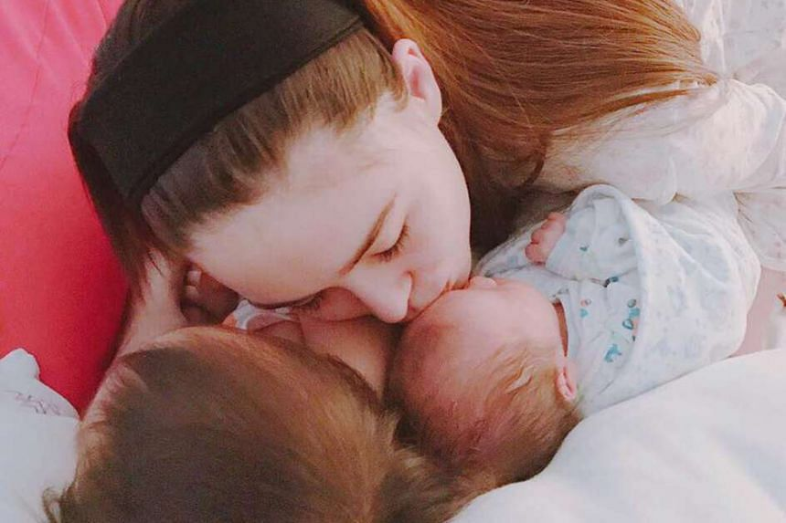 Jay Chou's wife, Hannah Quinlivan, with their newborn son and two-year-old daughter Hathaway, in a photo posted on Facebook.
