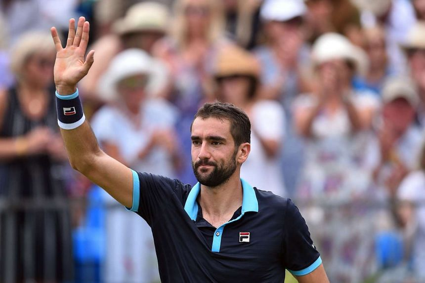 Croatia's Marin Cilic waves to the crowd after winning.