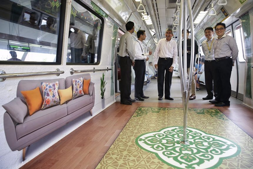 Minister-in-Charge of Muslim Affairs Dr Yaacob Ibrahim (centre) taking an inaugural ride on a Hari Raya themed train.