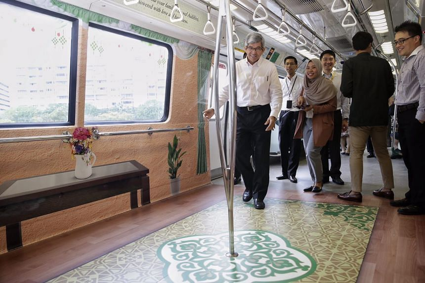 Minister-in-Charge of Muslim Affairs Dr Yaacob Ibrahim (front) taking an inaugural ride on a Hari Raya themed train.