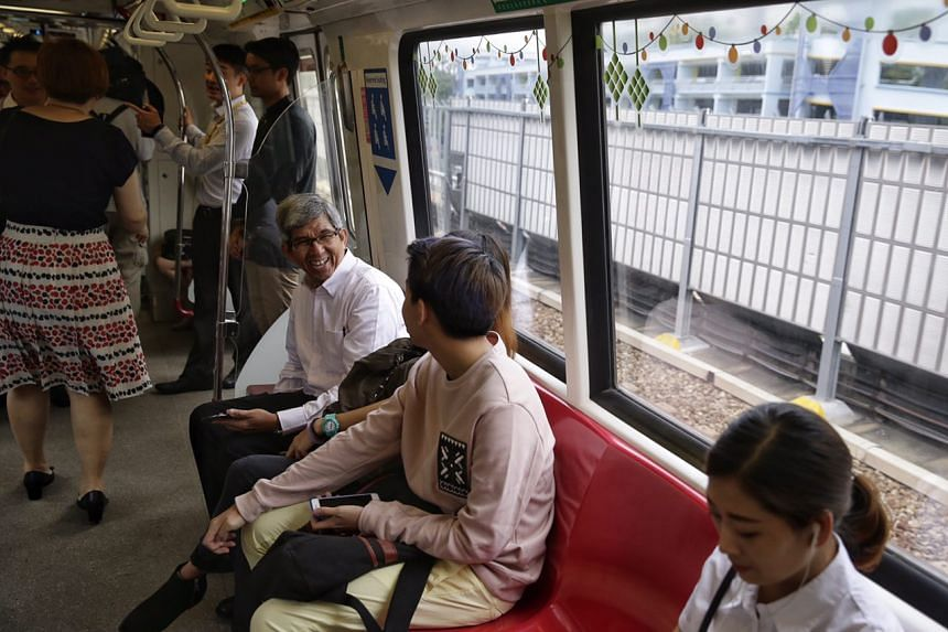 Minister-in-Charge of Muslim Affairs Dr Yaacob Ibrahim taking an inaugural ride on a Hari Raya themed train.