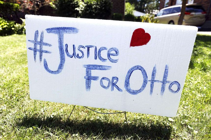 "A sign on the front lawn of Lauren Wadds Wyoming, Ohio home proclaims, ""#Justice For Otto"" as the the town of Wyoming prepares for the funeral of Otto Warmbier  on June 21, 2017."