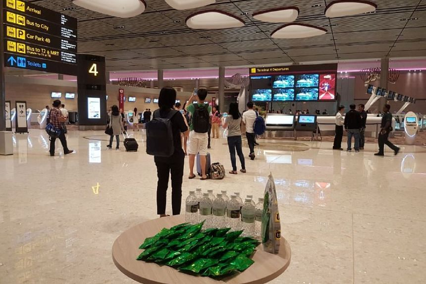 Travellers taking photos at Changi Airport Terminal 4 on June 23, 2017.