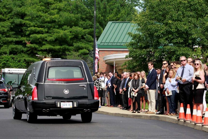 The hearse carrying Otto Warmbier departs for the cemetery after thea funeral service.