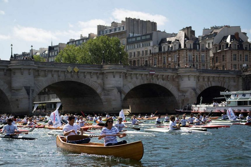 Paris Mayor Anne Hidalgo and co-president of the Paris bid for the 2024 Olympics Tony Estanguet rowing on the Seine river.
