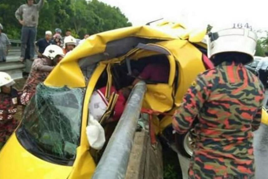 Firefighters attempting to remove the injured army personnel from the car wreckage.