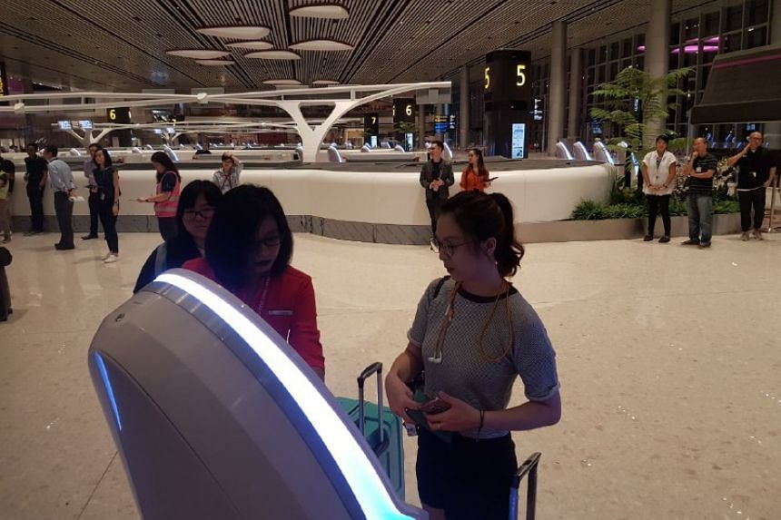 Travellers using the automated check-in systems at Terminal 4.
