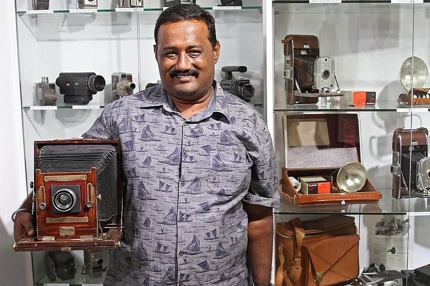 Mr S. Ramanathan, owner of the Vintage Camera's Museum (left), with a large format film camera.