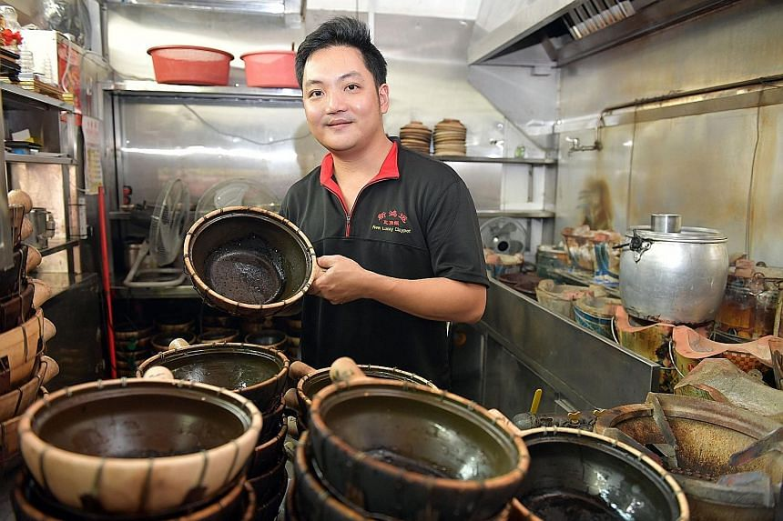 Secondgeneration owner Edmund Choong of New Lucky Claypot Rice in Holland Drive Market & Food Centre hopes being on the list means more people will try his dishes. Ah Er Soup owner Chen Hua Qiang and his wife Qu Fa Di. The stall's bestsellers are lot