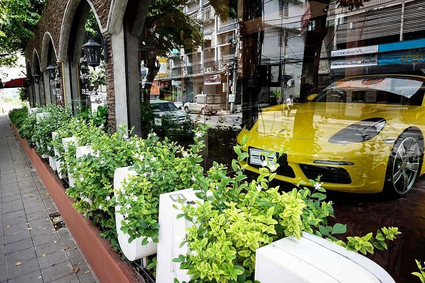 A sports car on display on June 14 in a Bangkok dealership accused of selling stolen cars. Thai investigators say dealers and corrupt Customs officials use scams and loopholes to circumvent high taxes.