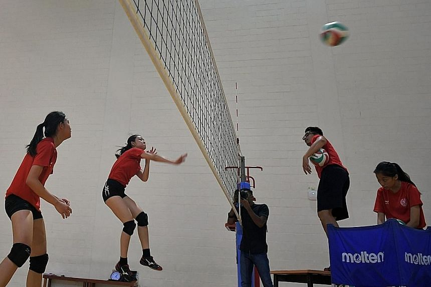 Singapore's Asean Schools Games volleyball squad training at Singapore Sports Hub ahead of the July 14-20 event. The Republic will play host for the first time since 2011.
