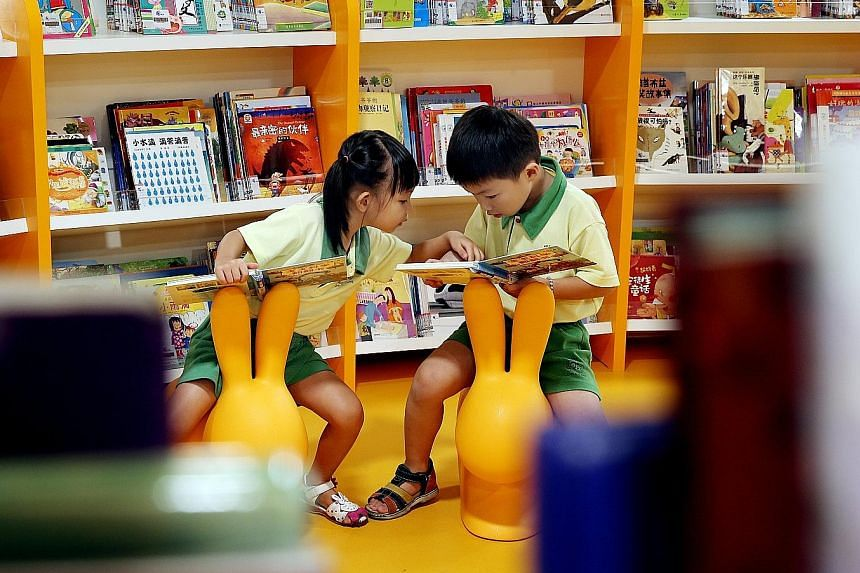 Bukit Panjang Public Library's redesigned children's space boasts a multimedia storytelling room that uses images, light and sound effects to create interactive sessions.
