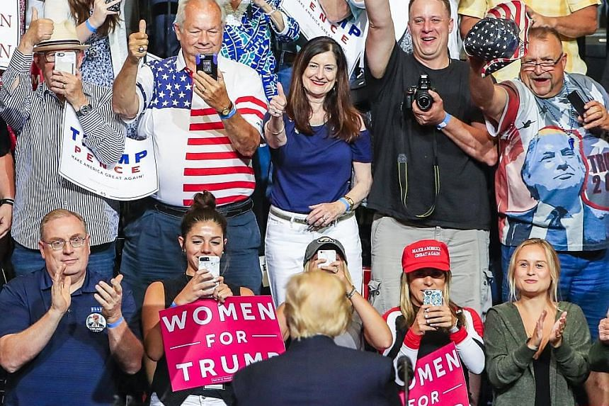 US President Donald Trump at a rally in Cedar Rapids on Wednesday. He spoke about his idea to build a solar wall along the US southern border and on renegotiating the North American free trade pact.