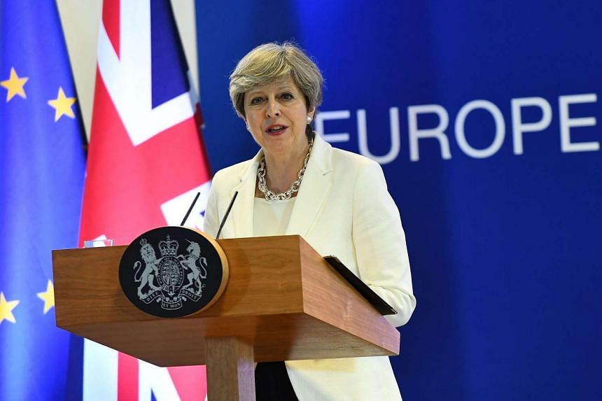 British Prime Minister Theresa May addresses a press conference at the end of a European Council meeting, on the second day of a summit of European Union (EU) leaders at the European Union headquarters in Brussels, on June 23, 2017.