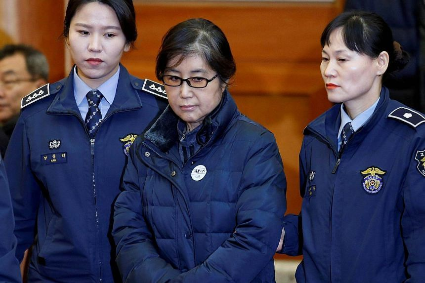 Choi Soon Sil (centre), the jailed confidante of disgraced South Korean President Park Geun Hye, arrives for a hearing at the Constitutional Court in Seoul.
